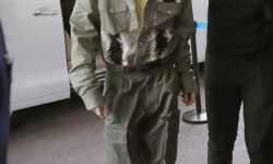 王俊凯军绿色连体裤现身机场